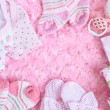 Layette for newborn baby girl — Stock Photo #72641059