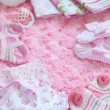 Layette for newborn baby girl — Stock Photo #72641069