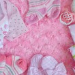Layette for newborn baby girl — Stock Photo #76708743