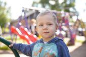 Little boy playing on a playground — ストック写真