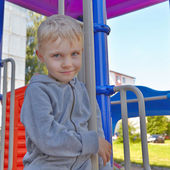 Little boy playing on a playground — Stock Photo