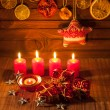 Image of Christmas decorations, candles, gifts on brown background — Stock Photo #59408119