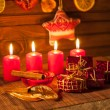 Image of Christmas decorations, candles, gifts on brown background — Stock Photo #59409103