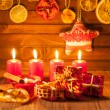 Image of Christmas decorations, candles, gifts on brown background — Stock Photo #59410263