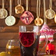 Glass of mulled wine and Christmas decorations, candles, gifts on linen background — Stock Photo #59417857