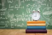 Back to school, books and an alarm clock — Stock Photo