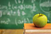 Apple on  school books — Photo
