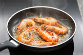 Fresh shrimps being fried in olive oil — Stock Photo
