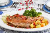 Christmas dish roasted turkey leg with gooseberries — Stock Photo