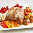 Tasty roasted loin pork with potatoes, bell peppers and gooseber — Stock Photo #61448007
