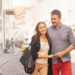 Couple walking in  the city — Stock Photo #66597279
