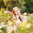 Woman in a rose garden — Stock Photo #66597535
