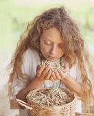 Woman smelling  dried herbs — Stock Photo