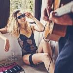 Girl watching her boyfriend playing guitar — Stock Photo #70993451