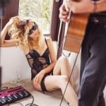 Girl watching her boyfriend playing guitar — Stock Photo #70993455