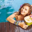 Woman drinking a coconut cocktail — Stock Photo #70994331