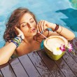 Woman drinking a coconut cocktail — Stock Photo #70994339