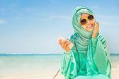 Muslim girl on  the beach — Stock Photo