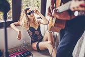Girl watching her boyfriend playing guitar — Stock Photo