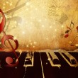 Music background with piano keys, music notes and treble clef — Stock Photo #60124805