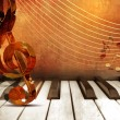 Music background with piano keys and music notes — Stock Photo #67166677