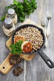 Chicken burgers and buckwheat — Stockfoto