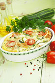 Zucchini baked with chicken, cherry tomatoes and herbs — Stock Photo