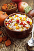 Sweet pilaf with pumpkin, apples and dried fruit — Stock Photo