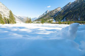 Snow fall early winter and late autumn. Alps landscape with snow capped mountains in the late autumn season. — Stock Photo
