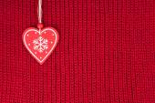 Background of wool knitted fabric with heart decoration — Stock Photo
