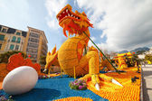 "MENTON, FRANCE - FEBRUARY 20: Dragon statue on Lemon Festival (Fete du Citron) on the French Riviera.The theme for 2015 was ""Tribulations of a lemon in China"". Menton, France - Feb 20, 2015 — Stock Photo"