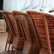 Four brown woden rattan armchairs — Stock Photo #75275347