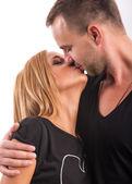 Couple kissing in  the studio — Stock Photo