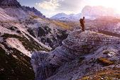 Male hiker standing on the barren rocks — Stock Photo