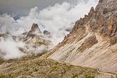 Barren rocks in the clouds — Stock Photo