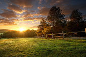 Fenced ranch at sunrise — Stock Photo