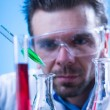 Man in the lab experimenting — Stock Photo #57720313