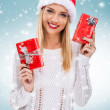 Woman holding two red gift boxes — Stock Photo #58433629