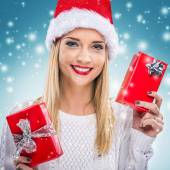 Woman holding two red gift boxes — Stock Photo