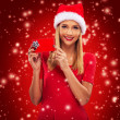Female Santa holding a gift box — Stock Photo #59277769
