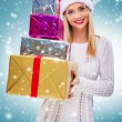 Female Santa with a gift boxes — Stock Photo #59277811
