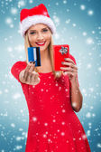 Female Santa with a credit card — Stock Photo