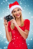 Female Santa with a camera — Stock Photo