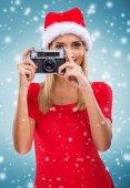 Female Santa with a camera — Stock Photo