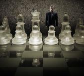 Glass chessboard with businessman — Stockfoto