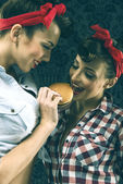 Vintage girlfriends feed of another girl — Stock Photo