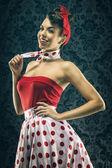 Kobieta w czerwonej kropki starodawny sukienka — Zdjęcie stockowe