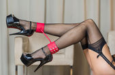 Legs with stockings, garter belt, ankle cuffs and high heels — Foto Stock