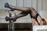 Legs with stockings, garter belt and high heels shoes — Fotografia Stock