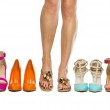 Woman is standing in slippers in between high heels shoes — Stock Photo #77270348
